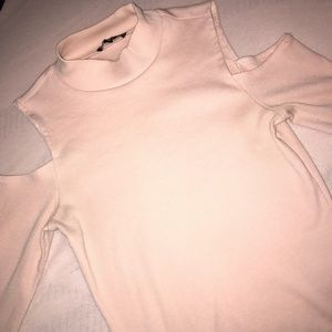 Pale pink top with cutoff shoulders